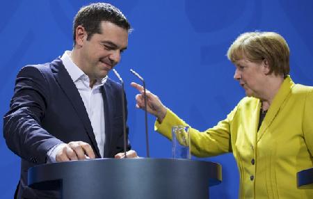 Greek Prime Minister Alexis Tsipraswith German Chancellor Angela Merkel