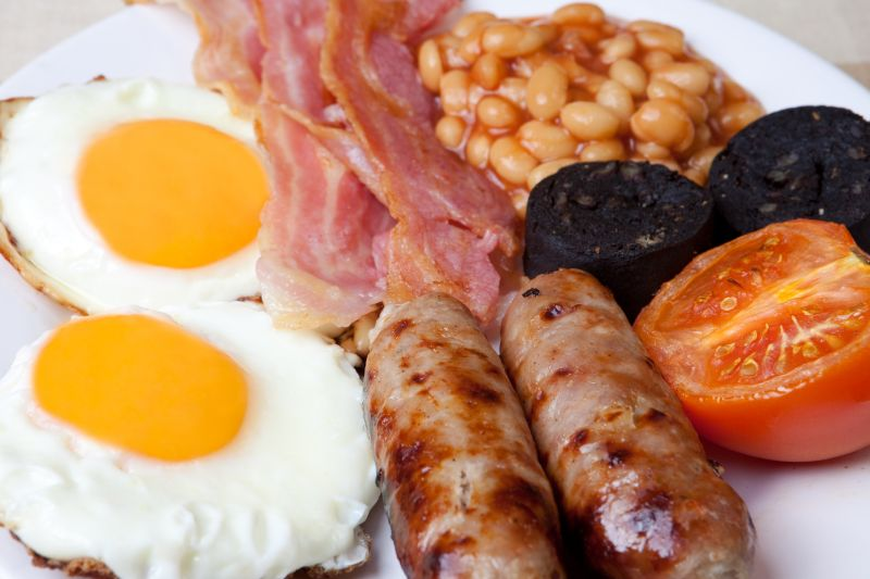 English breakfast: eggs, bacon and baked beans