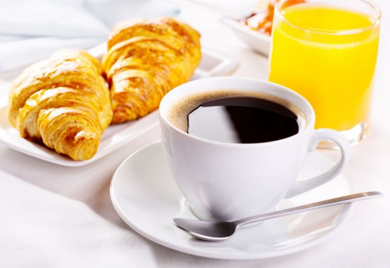 French breakfast: croissant, coffee and orange juice