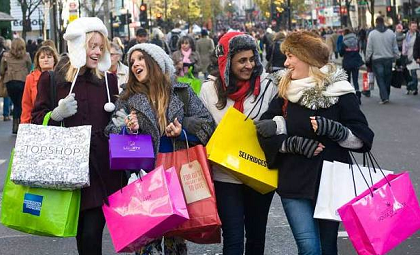 Girls shopping on the high street on a Sunday