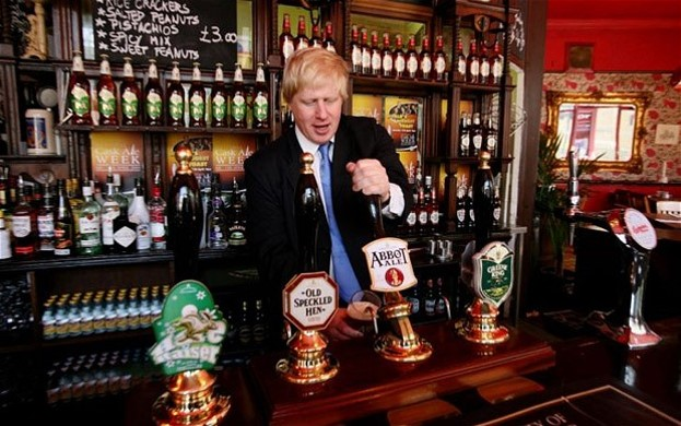 Boris Johnson serving a pint and not taking himself too seriously